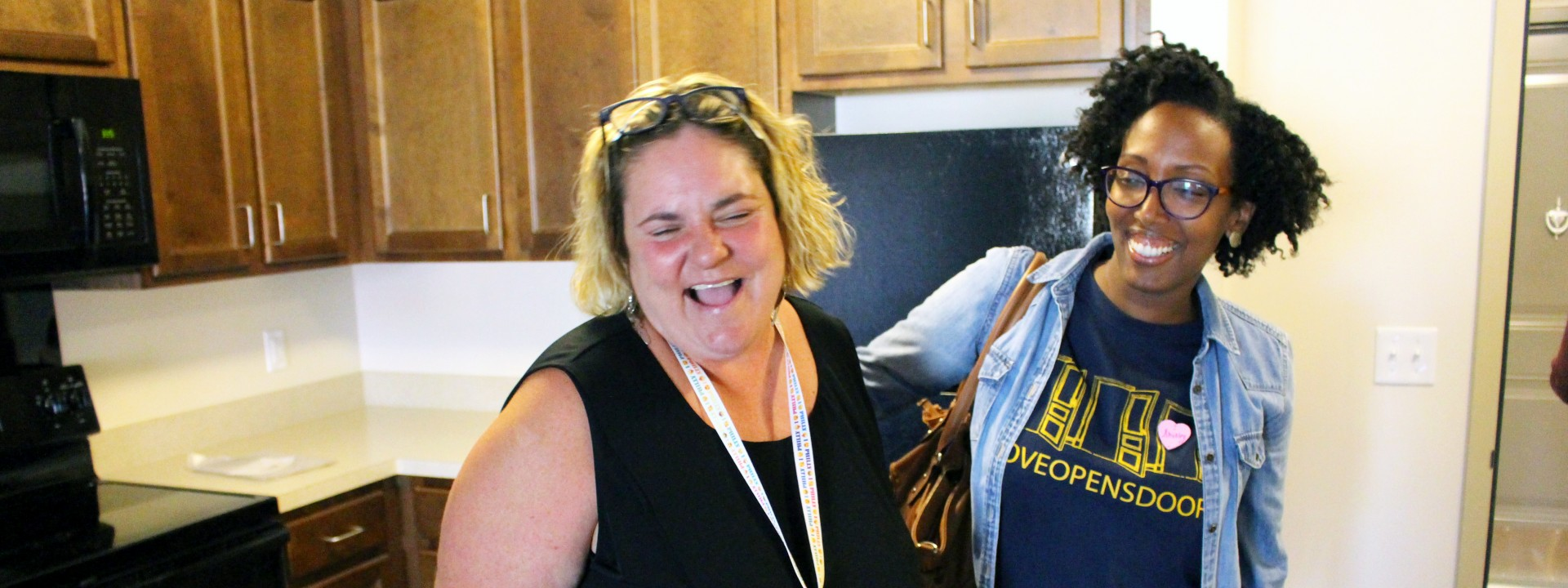 A new resident laughs with a Project HOME staffer
