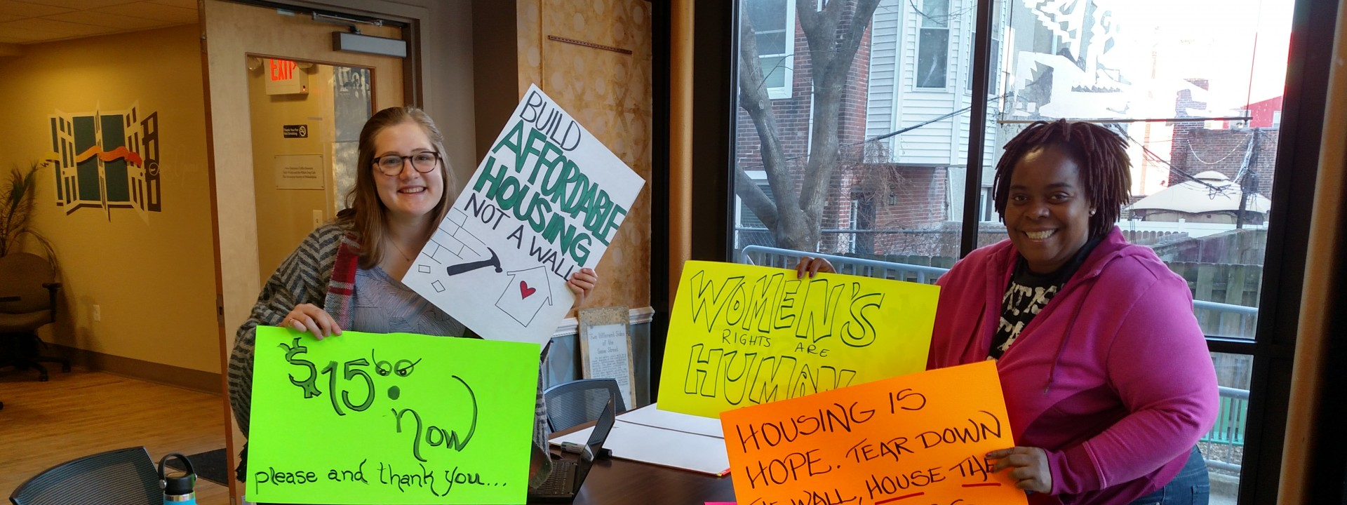 Project HOME advocates gathering signs for an action